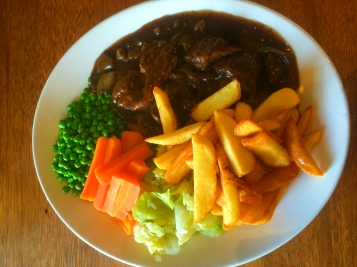 Braised Steak. Served with fresh vegetables and chunky chips.